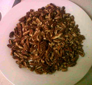 Roasted pecans on a sheet tray for 5-8 minutes at 350 degree oven.