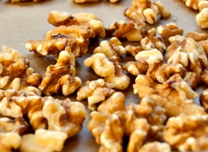 spread nuts on a parchment lined sheet tray, and place in a preheated oven at 400 degrees for about 5-7 minutes.