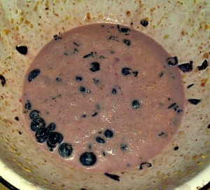 Take half of your wet mixture and blue berries and mash together in another bowl.