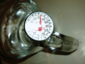 Use a thermometer as you don't want the water too hot, as it will kill the yeast.