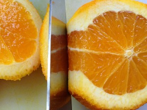 Using even downward strokes, slice the skin away from the flesh and discard.Make sure you take your time, and start at the top and slice downward as you work your way down the orange.